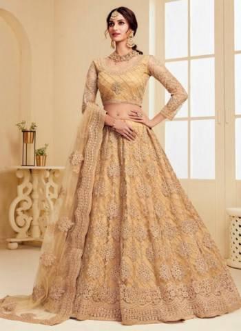 Golden Satin Silk Net Wedding Wear Embroidery Work Lehenga Choli