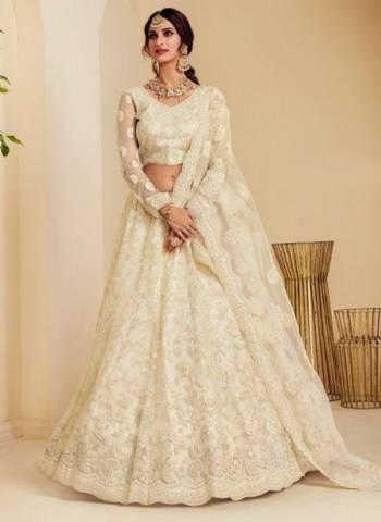 Off White Net Wedding Wear Embroidery Work Lehenga Choli