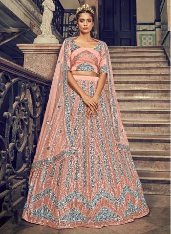 Peach Net Wedding Wear Sequins Work Fancy Lehenga Choli