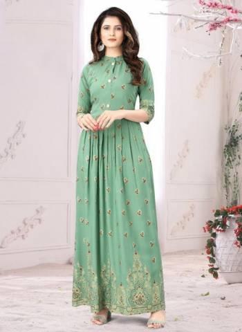 Pista Green Rayon Casual Wear Foil Printed Long Kurti