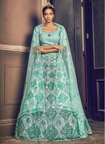 Turquoise Blue Net Wedding Wear Sequins Work Fancy Lehenga Choli